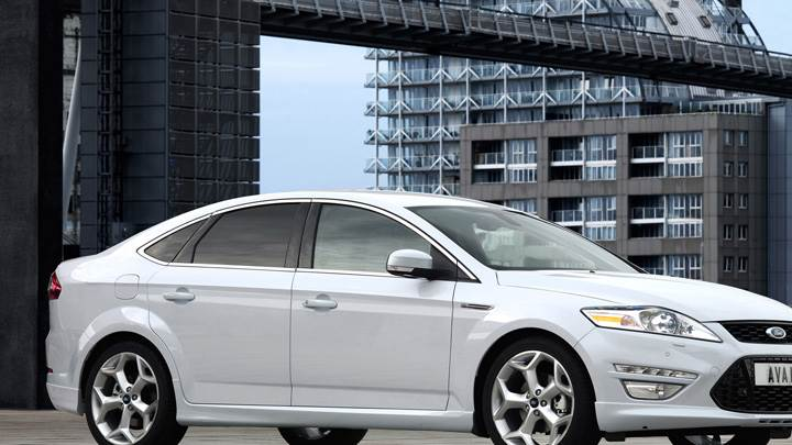 Side Pose Of 2011 Ford Mondeo In White